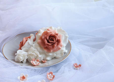 sugar veil: Rose sugar lie on a plate on veil