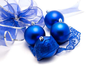 lace: blue Christmas balls with lace and bow on a white background closeup