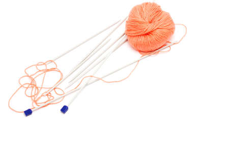 skein: knitting needles and a skein of wool yarn on a white background Stock Photo