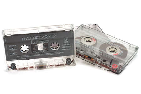 background information: DIKANKA, UKRAINE - NOVEMBER 26, 2015: Film tape cassettes used for recording and playback of music. Cassette with an inscription  on the manufacturer, the name of the artist  and a list of songs. Editorial