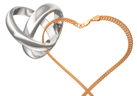 vows: Gold rings and chain on a white background. Rings connected gold chain. Heart of the chain