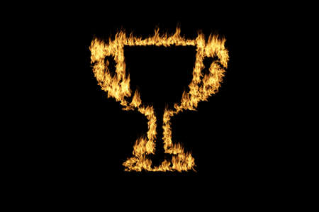 burning trophy cup with flame on dark background photo