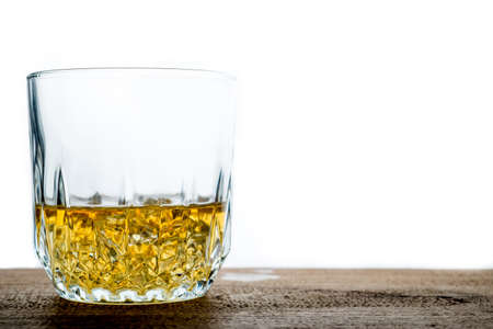 manlike: Whiskey glass with ice cubes on wooden
