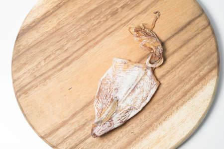dehydration squid on wooden plate