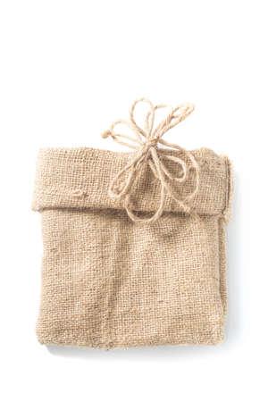 Empty burlap sack with hemp rope on white background