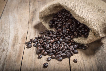 coffee beans on vintage wood table background