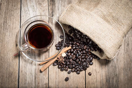 black coffee cup on vintage wood table background