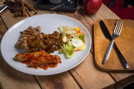 Pork Steak with Black Pepper on wood table