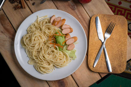 spaghetti with black pepper sauce on wood table