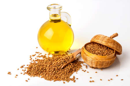 Fenugreek seeds spices and essential oils. Stock Photo