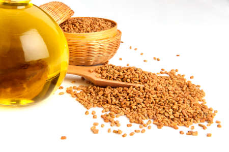 Fenugreek seeds spices and essential oils. Stok Fotoğraf