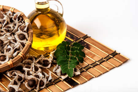 squeezing: Moringa Oil and seeds.