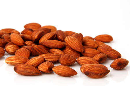 close up food: tasty almonds nuts isolated on white background. Stock Photo
