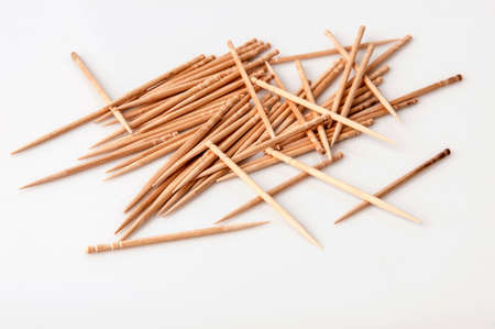 Pile of wooden toothpicks isolated on white.