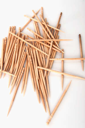 stirrer: Pile of wooden toothpicks isolated on white.