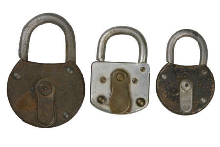 three old padlocks isolated on white photo