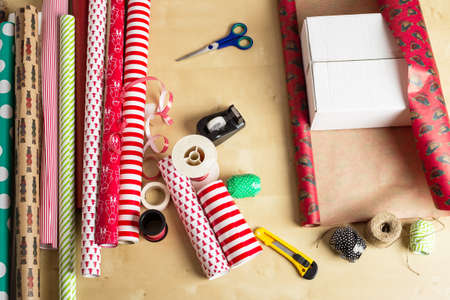 wrapping paper, scissors, tape and ribbon