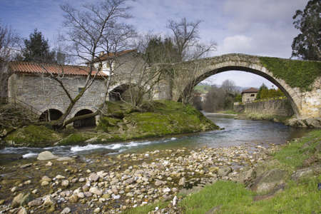Old bridge in Lierganes over Miera river Cantabria,Spain  photo