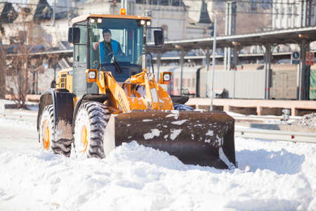 wheel loader: Wheel loader cleaning a road from snow in Russia