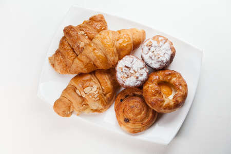 bakery products: Variety of bakery products on white plate