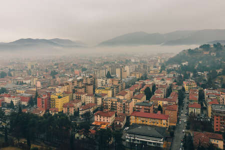 Lomard city of Brescia covered with morning mist