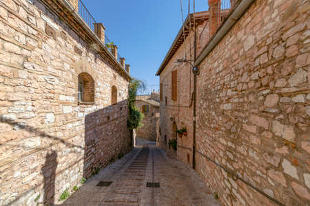 Narrow medieval street in Spello. Umbria, Italy
