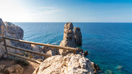 Beautiful seascape with rocks sticking out of the sea. Giglio Island (Isola del Giglio), Tuscany, Italy