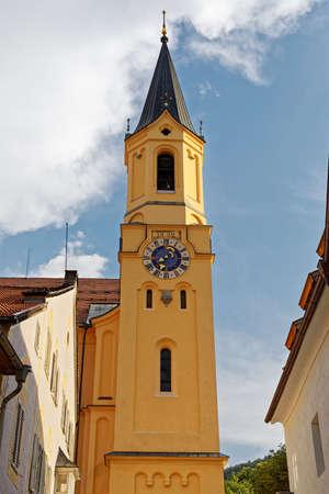 View of one of the clock towers of Parish Church Assumption of St. Mary (Chiesa Di Santa Maria Assunta) Bruneck (Brunico) Trentino-Alto Adige, Italy (vertical photo)