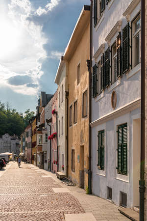 View of the central street of the picturesque Alpine town Bruneck (Brunico) Trentino-Alto Adige, Italy (vertical photo)