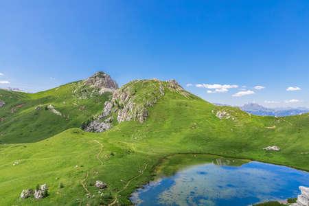 Beautiful small alpine lake (Lago di Valparola) Valparola Pass, Dolomites, Italy