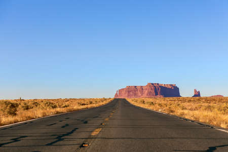 Empty scenic highway (Highway 163) leading to Monument Valley. Arizona, USA.