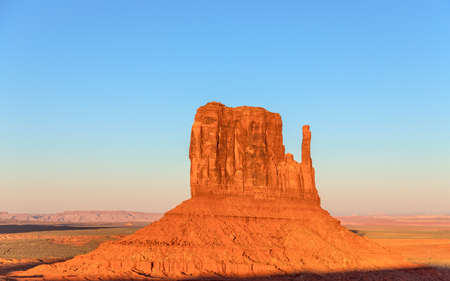 Beautiful sunset over famous Butte of Monument Valley on the border between Arizona and Utah, USA