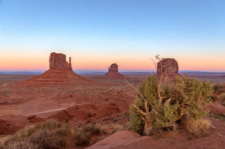 Beautiful sunset over famous Buttes of Monument Valley on the border between Arizona and Utah, USA