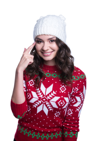 sexy sweater: Smiling pretty sexy young woman wearing colorful knitted sweater with christmas ornament and hat. Isolated on white background. Winter clothes
