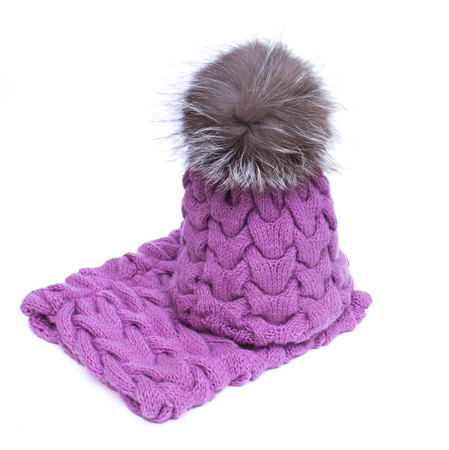 head scarf: Violet knitted woolen scarf and hat with pompom isolated on white background Stock Photo