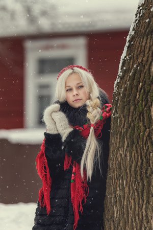 handkerchief: Portrait of a young caucasian woman in russian style on a strong frost in a winter snowy day. Russian model girl in traditional dress