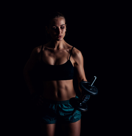 Portrait Of A Young Fitness Woman In Sportswear Doing Workout