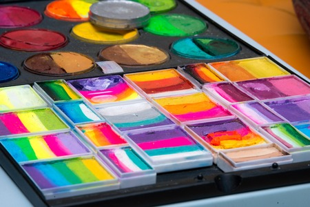 Set of watercolor paints in a box. Selective focus