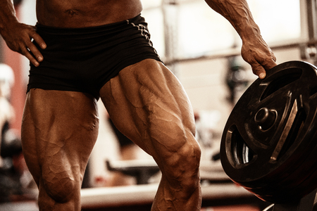 Close-up Of Bodybuilders Muscular Legs. Athlete Man Doing Workout ...