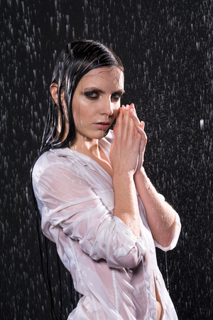Wet young sexy woman in aqua studio under the water drops