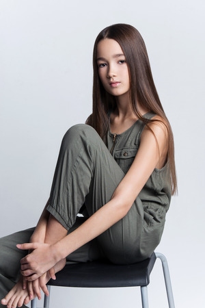 Portrait of beautiful young girl posing in studio
