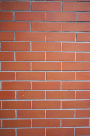 red wall: Red bricks in the wall.