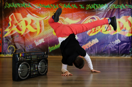 Breakdance dancer on an elbow at the boombox