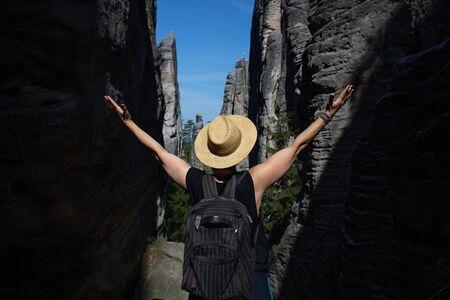Tourist in a hat enjoys the view. Prachovsk? sk?ly -Bohemian Paradise (?esk? r?j)