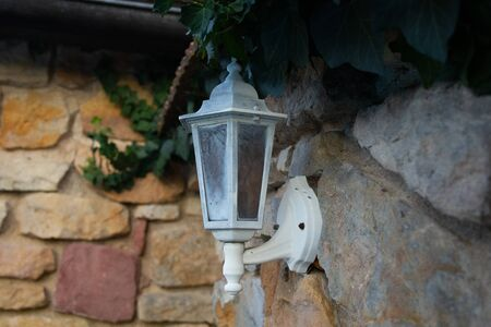 old street lamp on the wall, Czech republic Stock Photo