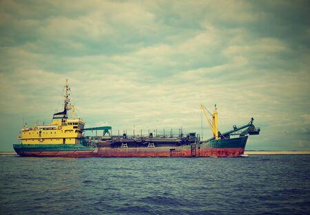 merchant ship entering the Baltic port in Poland Stok Fotoğraf