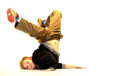 boy in a unique breakdance position, crazy child, special child