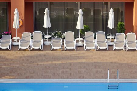 Public Vacation Spot Of A Hotel. Deserted view of the swimming pool.