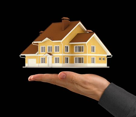 House Presentation. Miniature 3D model of a contemporary house above the facing up palm of a men's hand. Photo and graphic composition, Isolated on black background. Stockfoto