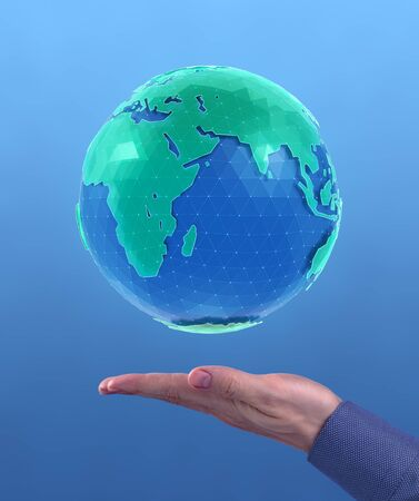 World Globe. 'Holographic' CG model of a globe levitating above of a facing up palm of a men's hand on blue background. Photo and 3D-render compositing.